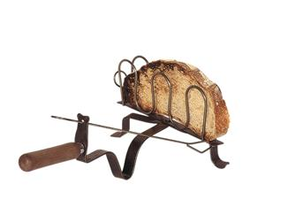 Wrought iron toaster for a fireplace
